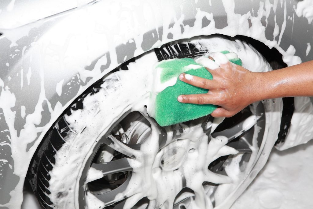 hand car wash cleaning wheels
